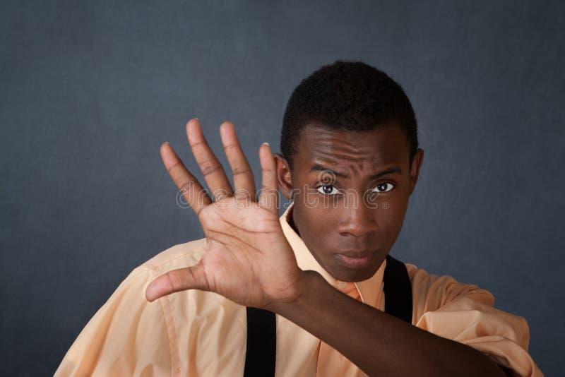De mens steunt Zijn Hand royalty-vrije stock afbeeldingen