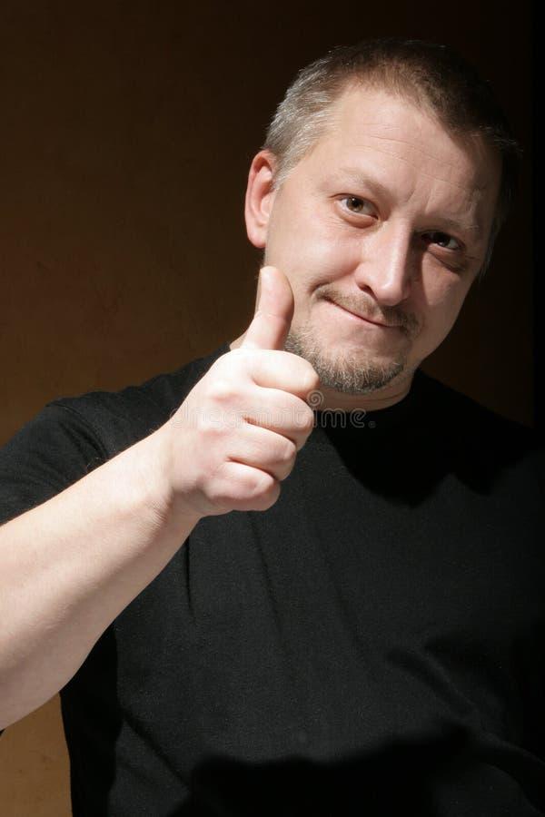 De mens toont de duim omhoog ondertekent stock afbeeldingen