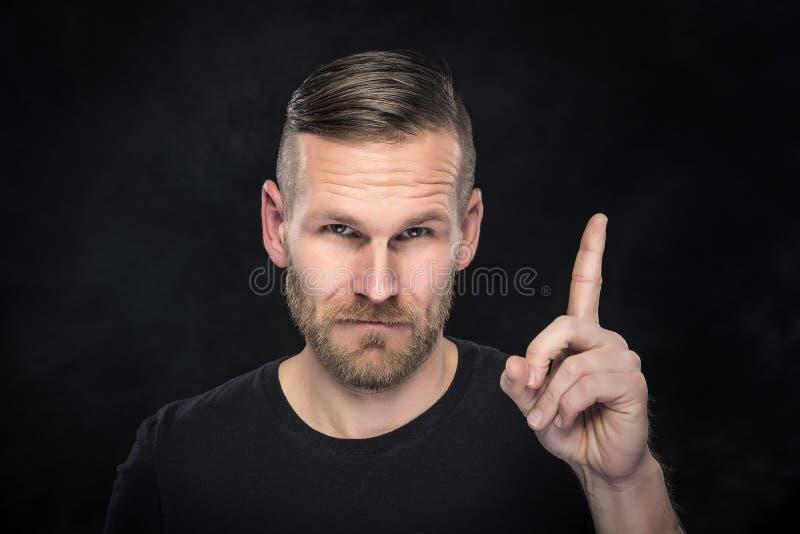 De mens toont duim stock foto's
