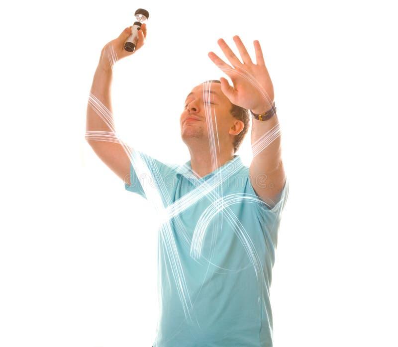 De mens trekt met licht in de lucht stock foto