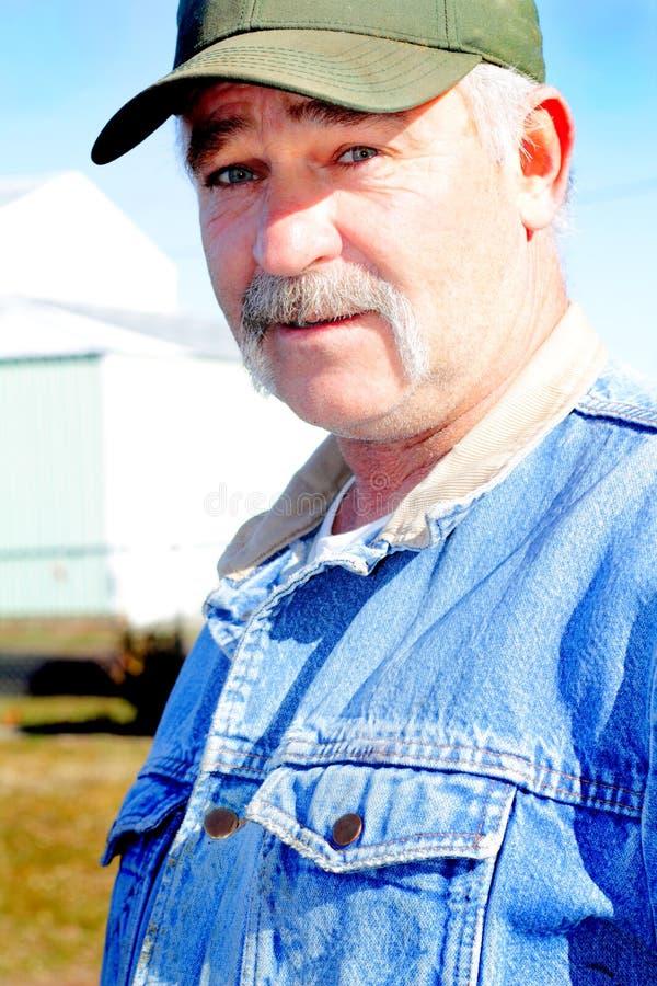 De Mens van de eigenaar van een ranch stock afbeeldingen