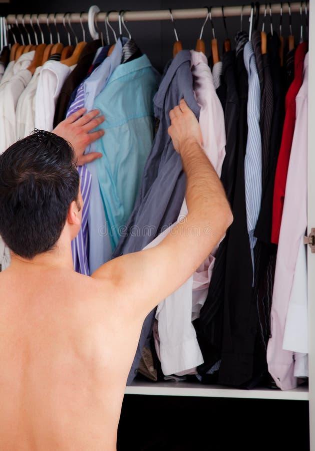 De mens van de garderobe stock foto