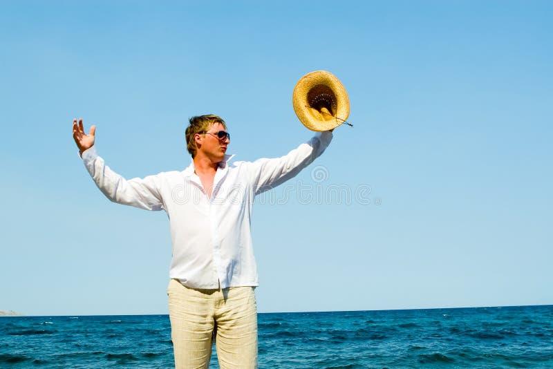 De mens van de macho met hoed royalty-vrije stock afbeelding