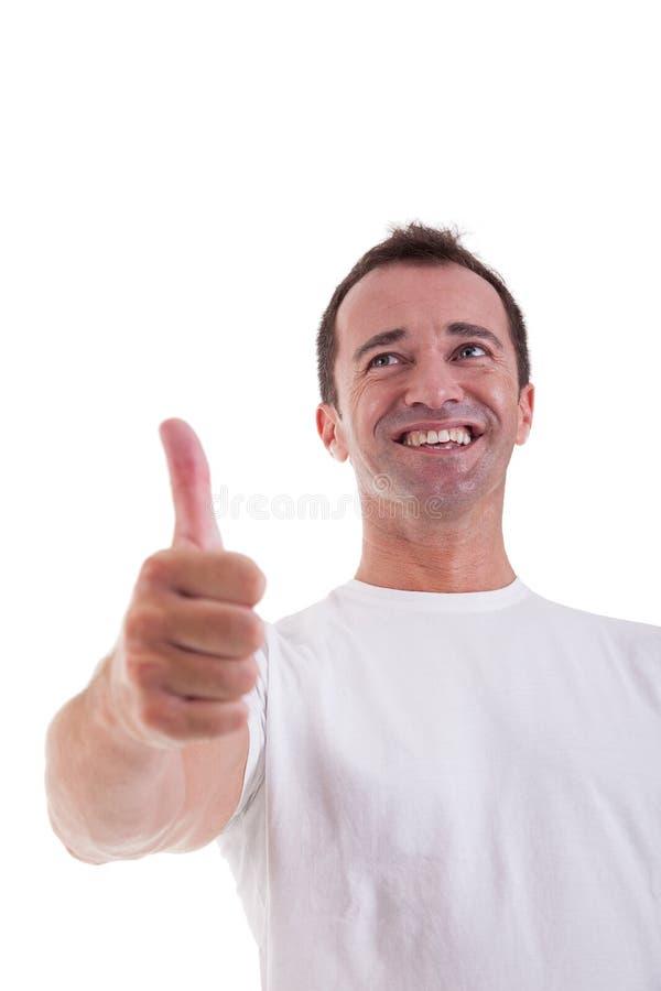 De mens van de midden-leeftijd met duim die als teken van succ wordt opgeheven stock fotografie