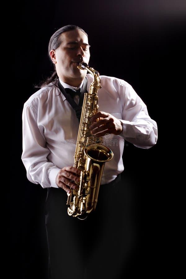 De mens van de saxofoon royalty-vrije stock afbeeldingen