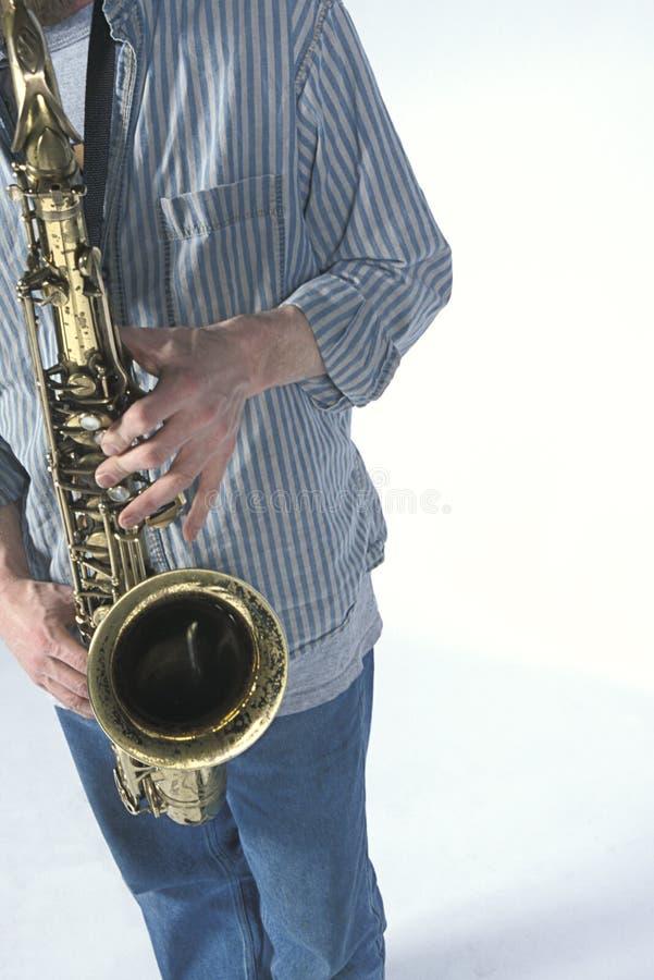 De Mens van de saxofoon royalty-vrije stock foto's