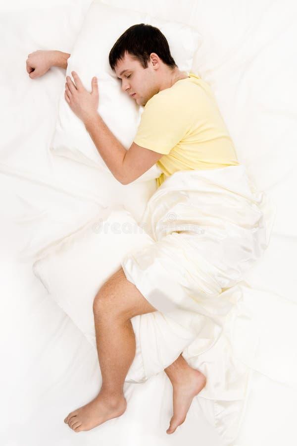 De mens van de slaap royalty-vrije stock afbeeldingen