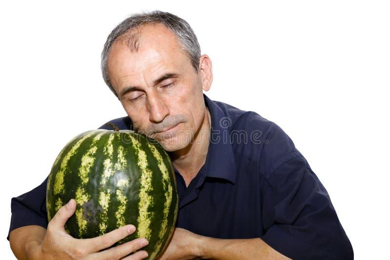 De mens van de slaap met watermeloen stock afbeelding