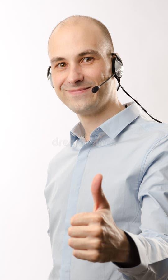 De mens van de vertegenwoordiger met een hoofdtelefoon royalty-vrije stock foto's
