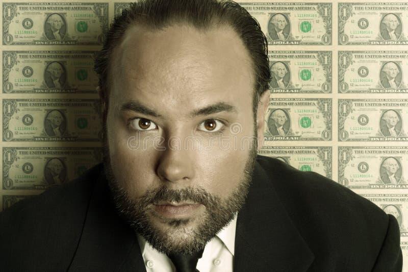 De mens van het geld stock afbeeldingen