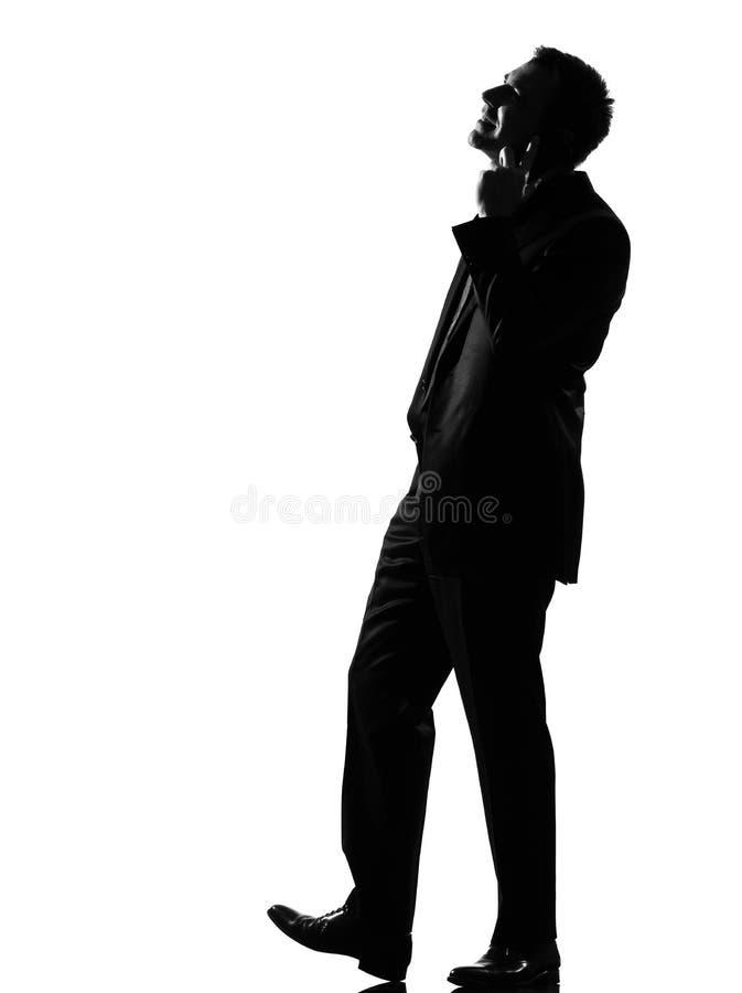 De mens van het silhouet op de telefoon royalty-vrije stock afbeeldingen