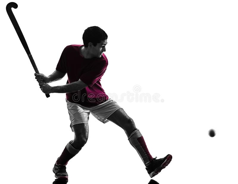 De mens van de hockeyspeler isoleerde silhouet witte achtergrond royalty-vrije stock foto