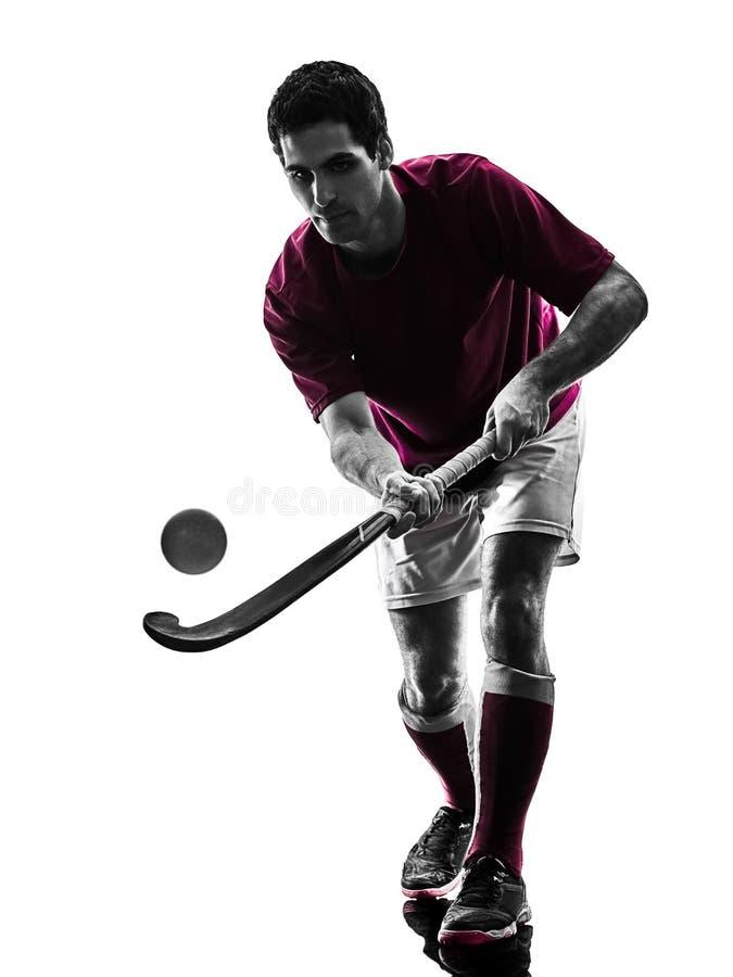 De mens van de hockeyspeler isoleerde silhouet witte achtergrond stock afbeeldingen