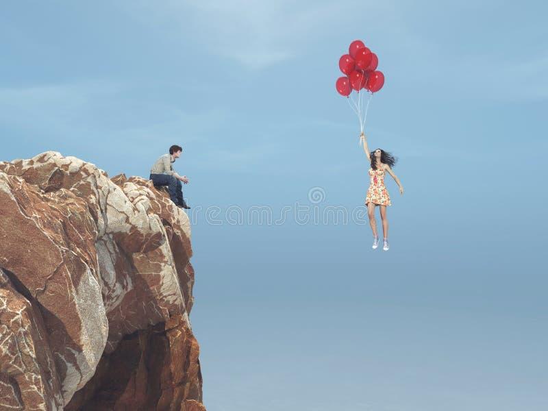 De mens zit op een heuvel en ziet een meisje vliegend met ballons stock illustratie