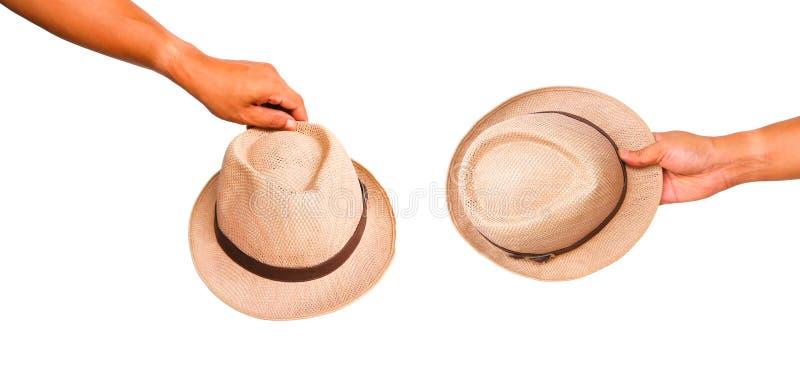 De menselijke hoed van de handholding royalty-vrije stock fotografie