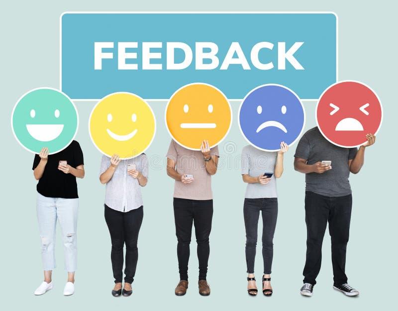 De mensen die klant tonen koppelen evaluatie terug emoticons royalty-vrije stock foto
