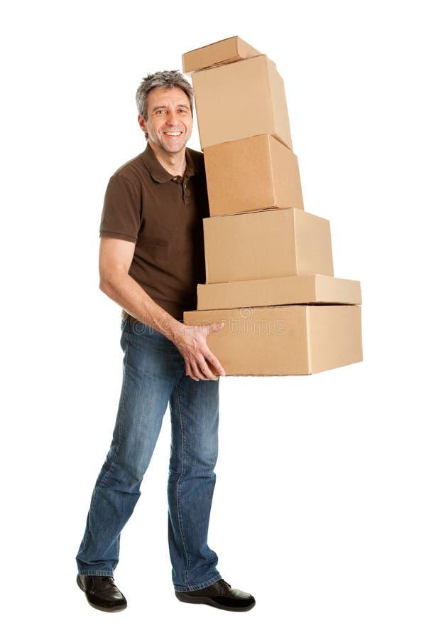De mensen dragende stapel van de levering dozen stock fotografie