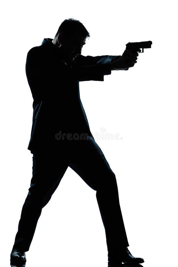 De mensen volledige lengte die van het silhouet met kanon ontspruit royalty-vrije stock afbeelding