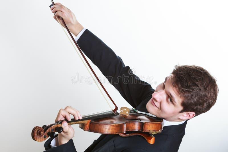 De mensenmens kleedde elegant het spelen viool royalty-vrije stock afbeeldingen