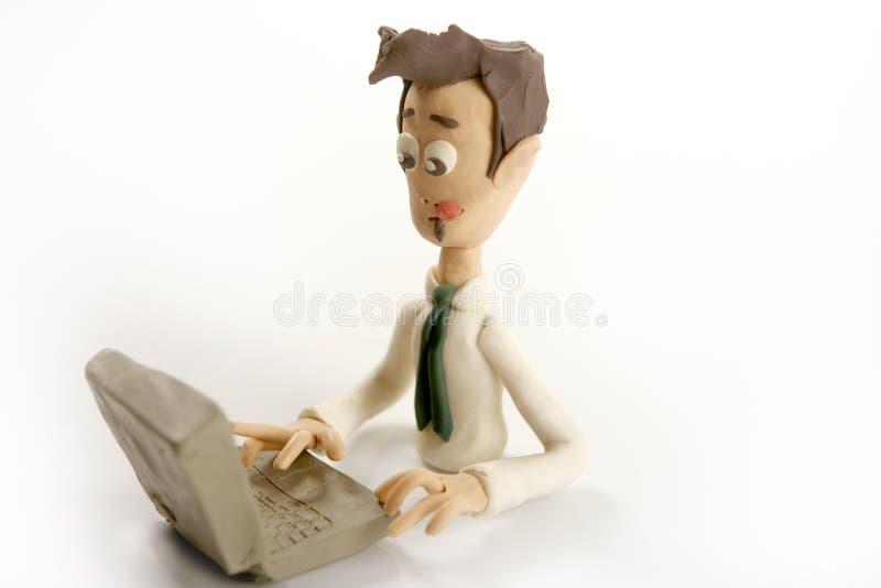 De met de hand gemaakte zakenman van de plasticine met laptop royalty-vrije stock afbeeldingen