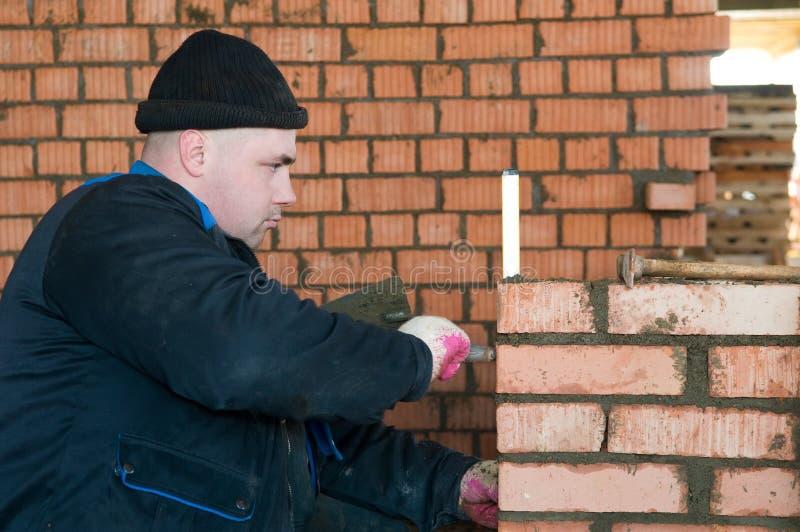 De metselaararbeider van de bouw stock fotografie
