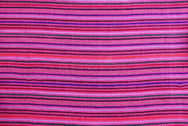 De Mexicaanse textuur van de serape trillende roze macrostof royalty-vrije stock afbeelding