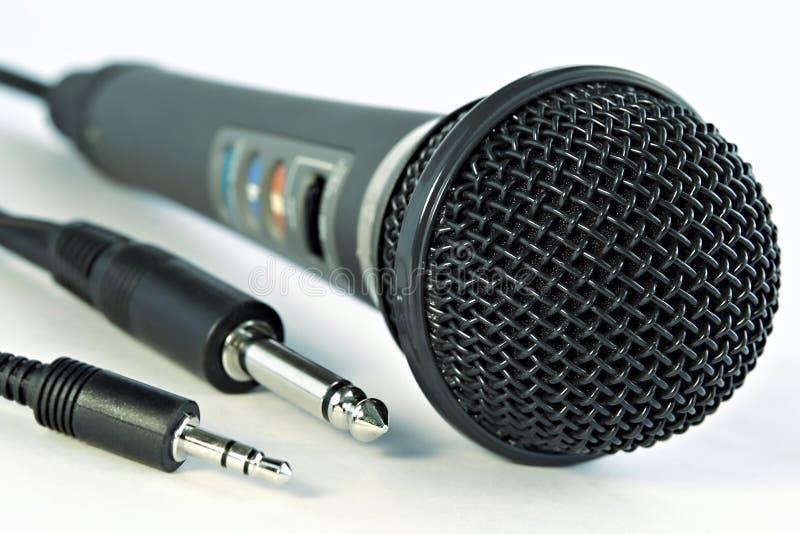 De microfoon en de hefbomen van de studio stock foto