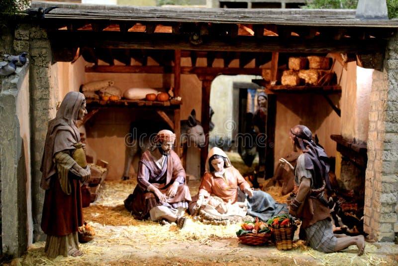 De miniatuurscène van de Kerstmisgeboorte van christus met Mary, Joseph en de baby Jesus royalty-vrije stock foto's