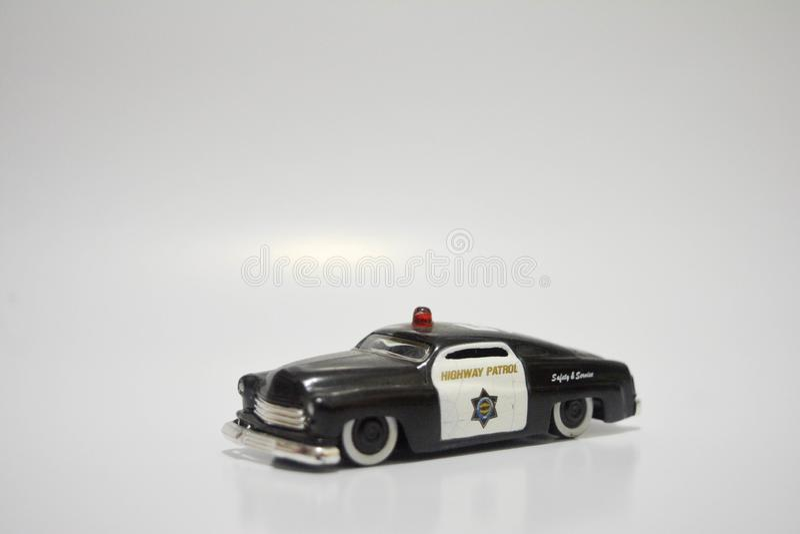 De miniatuurwegpatrouille isoleert witte achtergrond, inzamelingsspeelgoed stock foto's