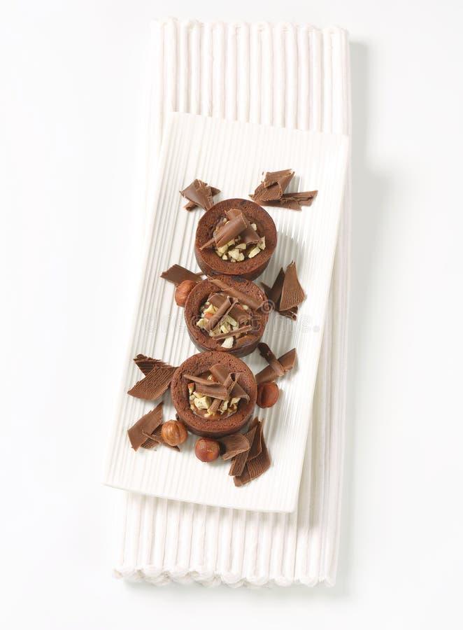 De minicakes van de chocoladehazelnoot stock afbeeldingen