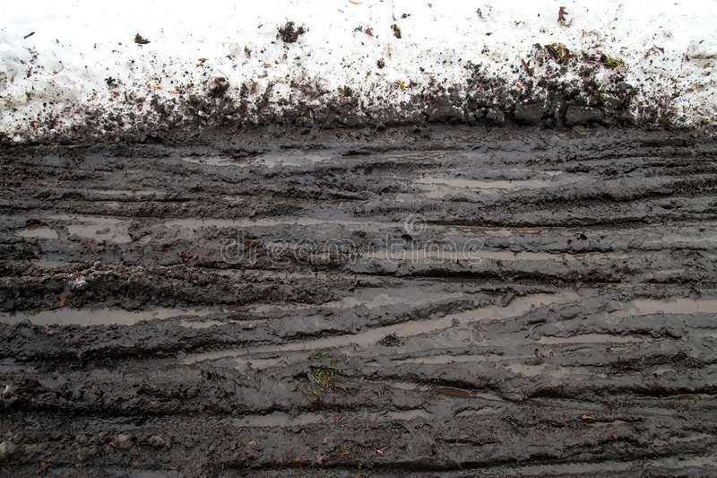 De Modder en de Sporen van de sneeuw stock afbeelding