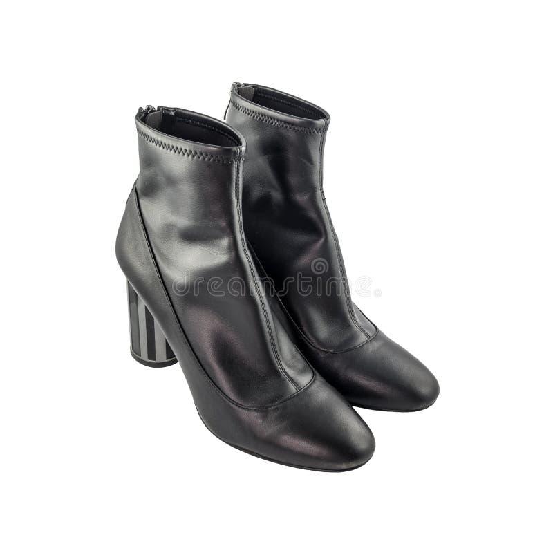 De modieuze geïsoleerde laarzen van het vrouwen` s leer stock foto