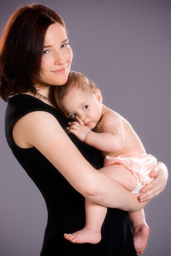 De moeder koestert Baby royalty-vrije stock foto