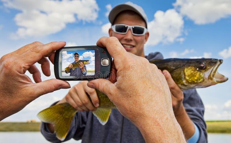 De momentopname van de visser stock afbeeldingen