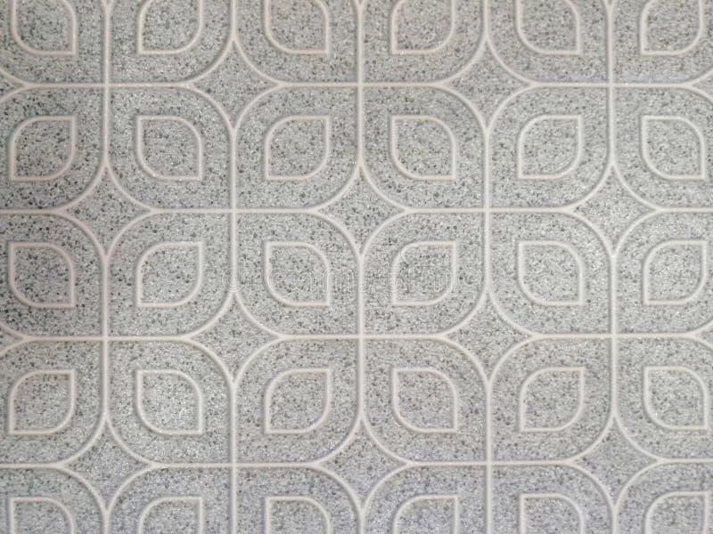 De mooie abstracte vloer van textuurtegels en de rotsplaat kleuren zwart-wit patroonachtergrond en behang stock afbeeldingen