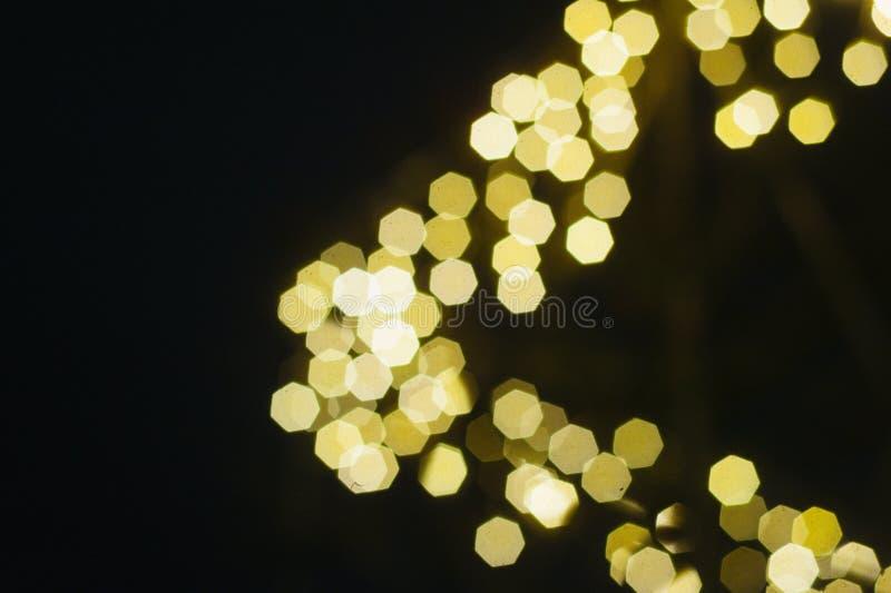 De mooie achtergrond van Kerstmis gouden bokeh met lege exemplaarruimte royalty-vrije stock foto's