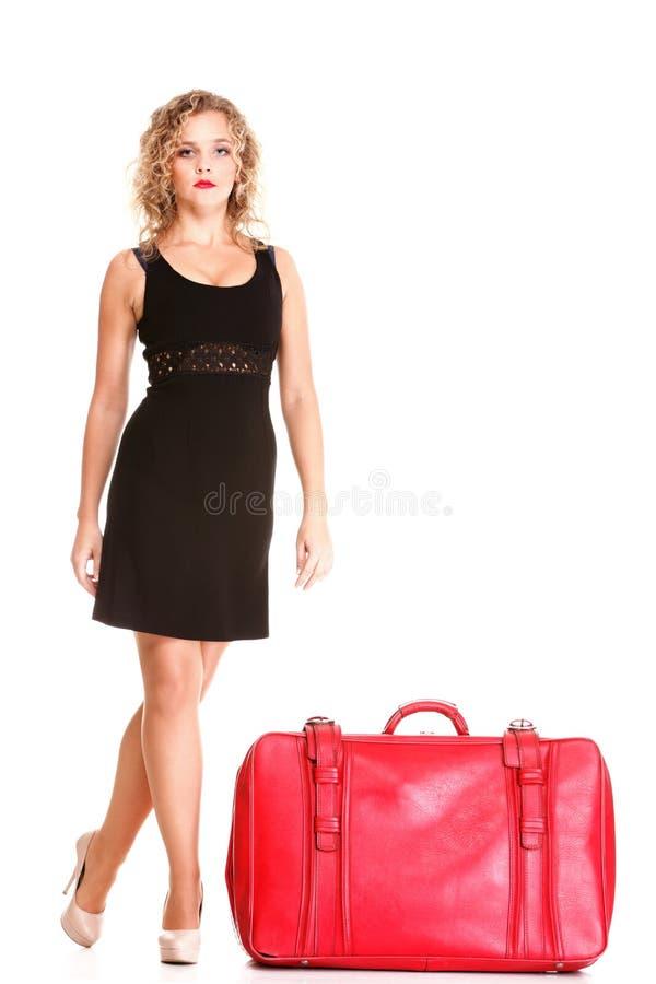 De mooie blonde krullende zak van de haar aantrekkelijke vrouw royalty-vrije stock afbeelding