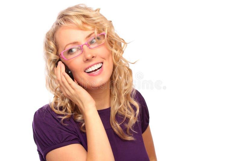 De mooie blonde met telefoon stock afbeeldingen