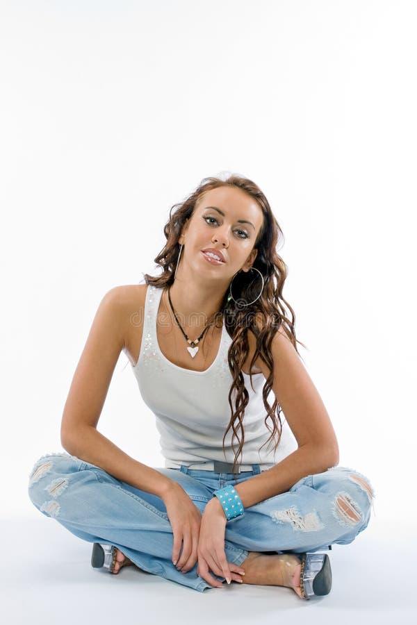 De mooie brunette in studio stock foto