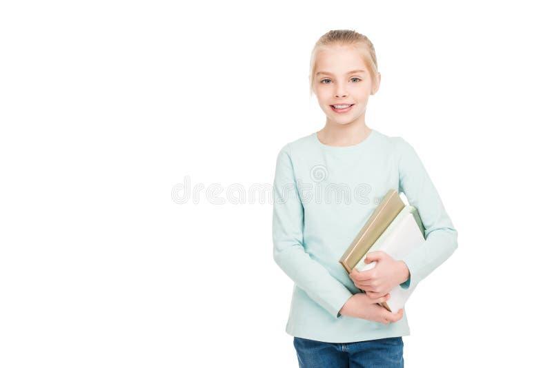 de mooie gelukkige boeken van de schoolmeisjeholding en het glimlachen bij camera stock afbeeldingen