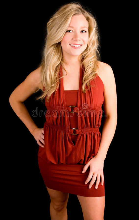 De mooie Glimlachende Dame van de Blonde in een Rode Kleding stock fotografie