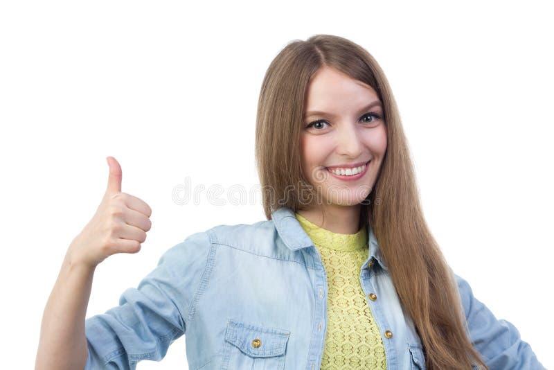 De mooie het glimlachen duim van de meisjesholding omhoog royalty-vrije stock afbeeldingen