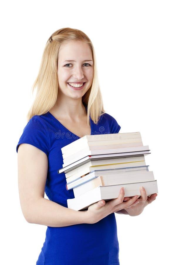 De mooie het glimlachen vrouwelijke boeken van de studentenholding royalty-vrije stock afbeeldingen