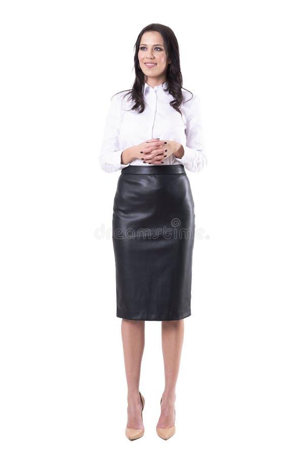 De mooie jonge bedrijfsvrouw met clasped handen wachtend op vergadering stock fotografie