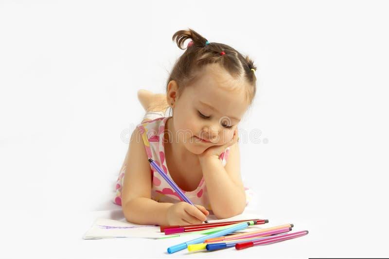 De mooie potloden van de meisjestekening royalty-vrije stock afbeelding