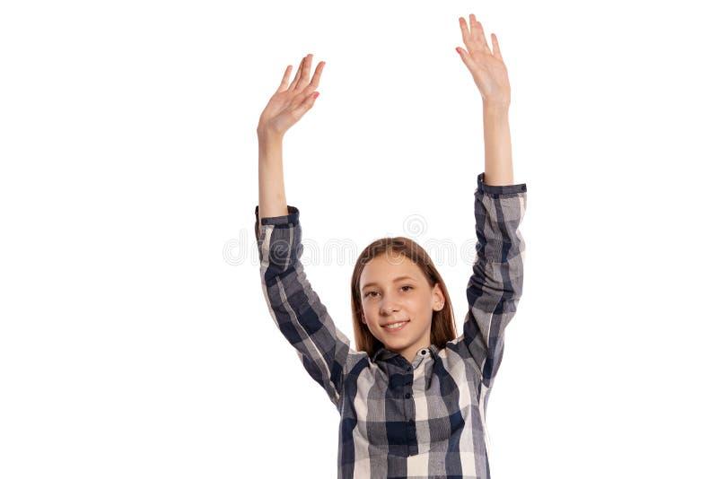 De mooie tiener in een toevallig geruit overhemd die isoleert op witte studioachtergrond stellen stock foto
