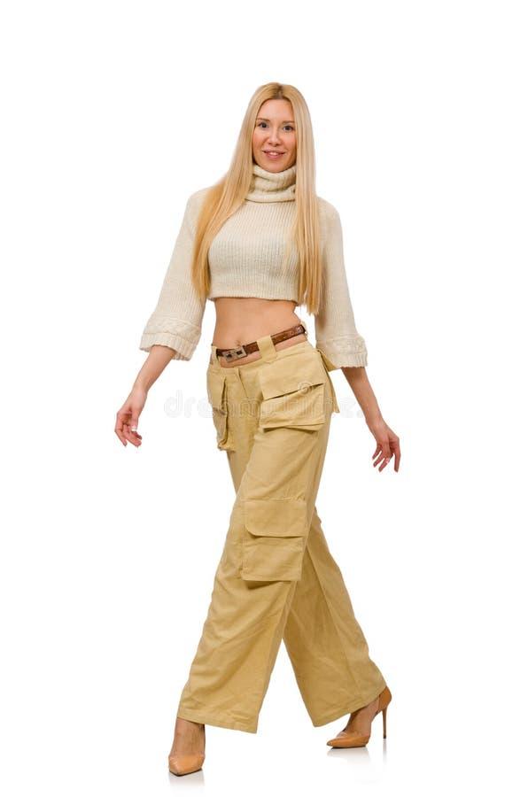 De mooie vrouw in beige die broeken op wit wordt geïsoleerd royalty-vrije stock afbeeldingen
