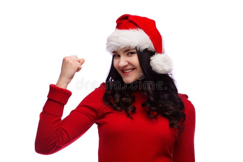 De mooie vrouw die van Kerstmissanta gebaar van macht van succes tonen Geïsoleerde royalty-vrije stock afbeelding