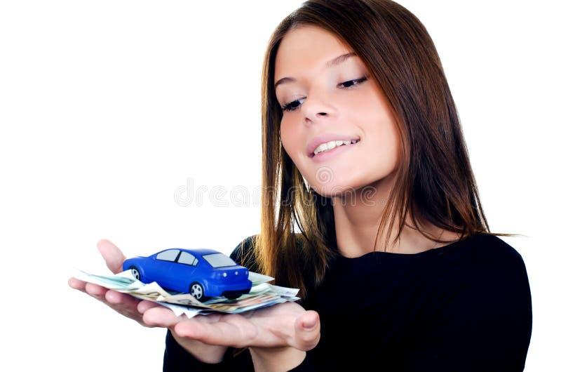 De mooie vrouw met geld en stuk speelgoed auto royalty-vrije stock foto's