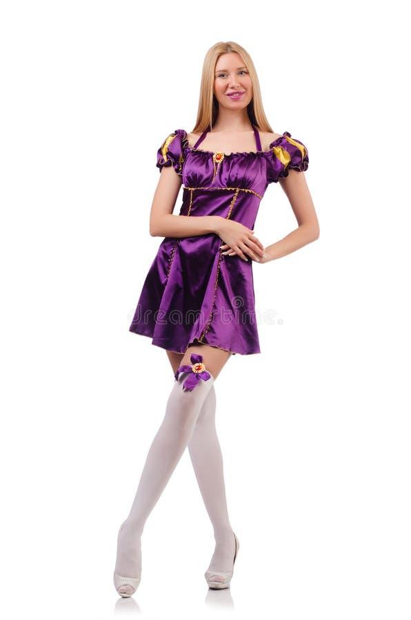 De mooie vrouw in purpere suèdekleding stock foto